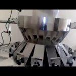 Automaattinen monipainopaino, jota käytetään pystysuoran täytteen tiivistyskoneen linjaan